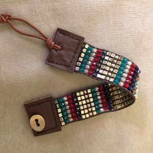 Jewelry - Finely beaded wristband with leather fastening.